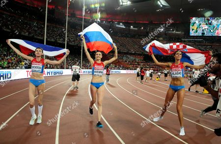 Russia's Maria Kuchina, center, Croatia's Blanka Vlasic, right, and Russia's Anna Chicherova celebrate after the women's high jump final at the World Athletics Championships at the Bird's Nest stadium in Beijing, . Kuchina won the event, Vlasic took second place and Chicherova placed third