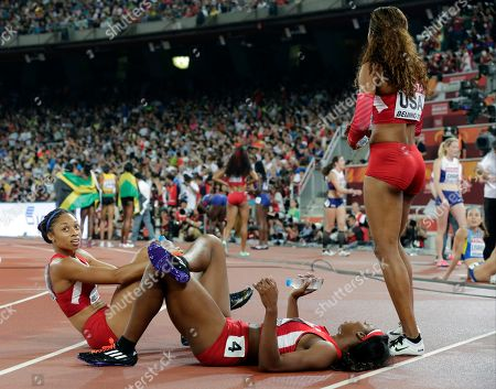 Allyson Felix of the United States, left, Francena Mccorory and Sanya Richards-Ross, right, watch as the Jamaican team celebrate their gold medal in the women's 4x400m relay at the World Athletics Championships at the Bird's Nest stadium in Beijing