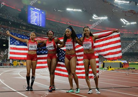 Allyson Felix of the United States, left, Francena Mccorory Natasha Hastings, and Sanya Richards-Ross after taking the silver medal in the women's 4x400m relay at the World Athletics Championships at the Bird's Nest stadium in Beijing