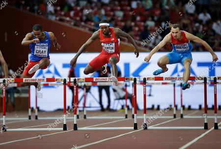 Eric Cray, Bershawn Jackson, Ivan Shablyuyev Philippines's Eric Cray, left, United States' Bershawn Jackson, center and Russia's Ivan Shablyuyev run in a men's round one heat of the 400m hurdles at the World Athletics Championships at Bird's Nest stadium in Beijing