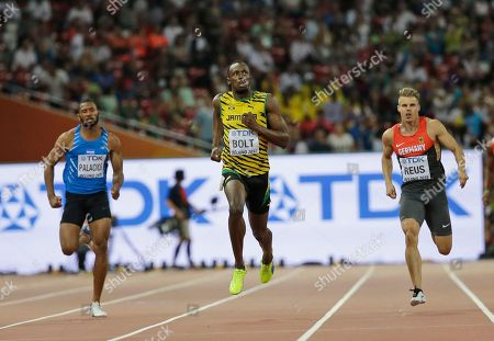 Jamaica's Usain Bolt, middle, Honduras' Rolando Palacios, left and Germany's Julian Reus compete in round one of the men's 200m at the World Athletics Championships at the Bird's Nest stadium in Beijing