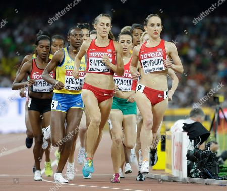 United States' Jennifer Simpson, left, and United States' Shannon Rowbury compete in the women's 1500m final at the World Athletics Championships at the Bird's Nest stadium in Beijing