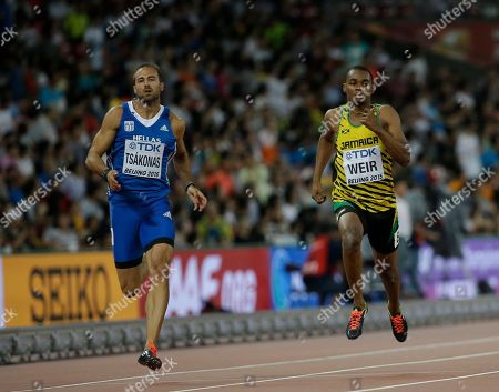 Stock Photo of Jamaica's Warren Weir, right, and Greece's Likourgos-Stefanos Tsakonas compete in round one of the men's 200m at the World Athletics Championships at the Bird's Nest stadium in Beijing