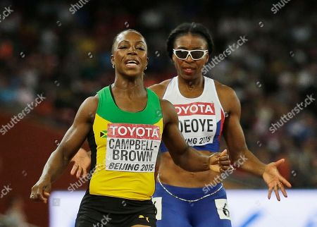 Jamaica's Veronica Campbell-Brown, left, runs in the same lane with Britain's Margaret Adeoye as they compete in a round one heat of the women's 200m at the World Athletics Championships at the Bird's Nest stadium in Beijing
