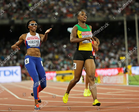 Britain's Margaret Adeoye, left, gestures towards Jamaica's Veronica Campbell-Brown, right, who switched lanes when competing in a round one heat of the women's 200m at the World Athletics Championships at the Bird's Nest stadium in Beijing