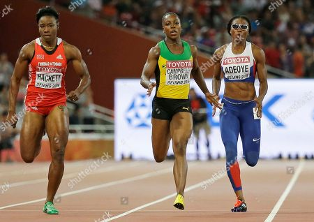 Trinidad and Tobago's Semoy Hackett, left, Jamaica's Veronica Campbell-Brown, middle and Britain's Margaret Adeoye compete in a round one heat of the women's 200m at the World Athletics Championships at the Bird's Nest stadium in Beijing, . Campbell-Brown switched lanes during the race in finished in Adoye's lane