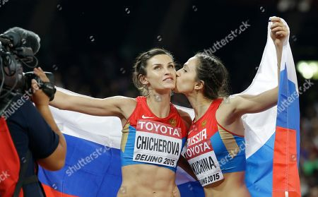 Russia's Maria Kuchina, right, and Russia's Anna Chicherova celebrate after the women's high jump final at the World Athletics Championships at the Bird's Nest stadium in Beijing, . Kuchina won the event and Chicherova placed third