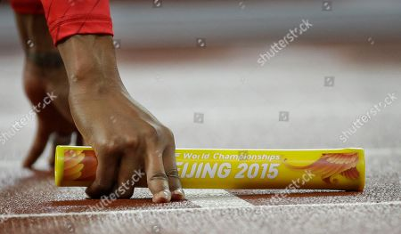 United States' Sanya Richards-Ross holds the baton as she waits to start the women's 4x400 relay final at the World Athletics Championships at the Bird's Nest stadium in Beijing