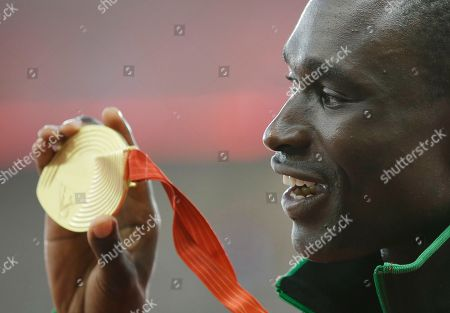 Men's 800m gold medal winner Kenya's David Rudisha poses for a photo during the medal ceremony at the World Athletics Championships at the Bird's Nest stadium in Beijing