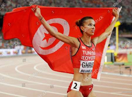 Tunisia's Habiba Ghribi celebrates after winning a silver medal in the women's 3000m steeplechase final at the World Athletics Championships at the Bird's Nest stadium in Beijing