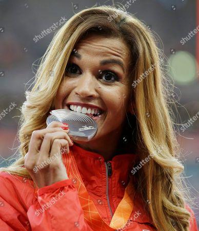 Women's 3000m steeplechase silver medalist Tunisia's Habiba Ghribi celebrates on the podium at the World Athletics Championships at the Bird's Nest stadium in Beijing