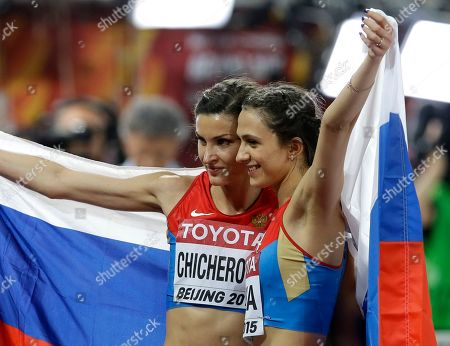Russia's Maria Kuchina, right, celebrates after winning the gold medal in the women's high jump final with compatriot and bronze medalist Anna Chicherova at the World Athletics Championships at the Bird's Nest stadium in Beijing