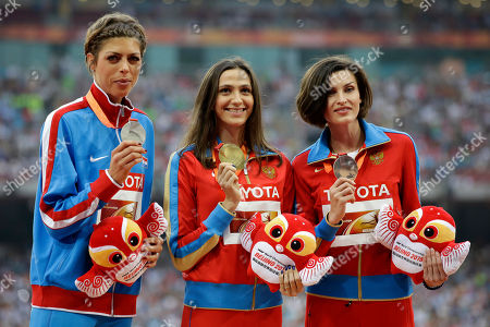 Women's high jump gold medalist Russia's Maria Kuchina, centre, stands with silver medalist Croatia's Blanka Vlasic, left, and compatriot and bronze medalist Anna Chicherova on the podium at the World Athletics Championships at the Bird's Nest stadium in Beijing