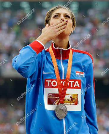 Women's high jump silver medalist Croatia's Blanka Vlasic celebrates on the podium at the World Athletics Championships at the Bird's Nest stadium in Beijing