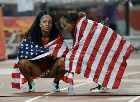 United States' women's 4x400m relay teammates from Natasha Hastings, left, chats with Sanya Richards-Ross, after their second place finish in the World Athletics Championships at the Bird's Nest stadium in Beijing