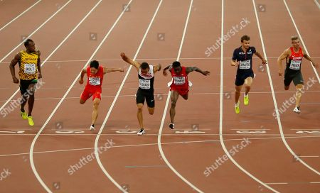 Jamaica's Usain Bolt, China's Su Bingtian, Canada's Andre De Grasse, United States' Trayvon Bromell, France's Christophe Lemaitre and Germany's Julian Reus, from left, cross the line of a men's 100m semifinal at the World Athletics Championships at the Bird's Nest stadium in Beijing