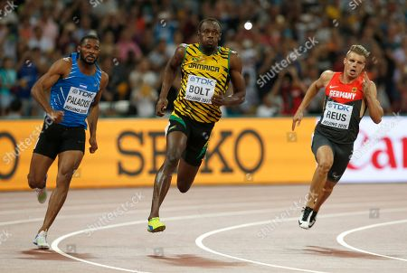 From left: Honduras' Rolando Palacios, Jamaica's Usain Bolt and Germany's Julian Reus in a men's 200m round one heat at the World Athletics Championships at the Bird's Nest stadium in Beijing