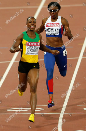 Jamaica's Veronica Campbell-Brown crosses the line after running in the lane of Britain's Margaret Adeoye, right, in a women's 200m heat during the World Athletics Championships at the Bird's Nest stadium in Beijing