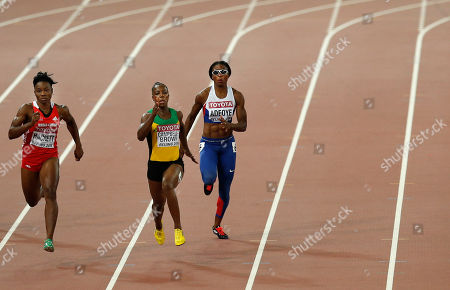 Stock Picture of Jamaica's Veronica Campbell-Brown, center, runs in the lane of Britain's Margaret Adeoye, right, as they compete with Trinidad and Tobago's Semoy Hackett in a women's 200m heat during the World Athletics Championships at the Bird's Nest stadium in Beijing