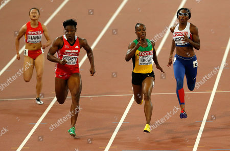Jamaica's Veronica Campbell-Brown, second right, runs in the lane of Britain's Margaret Adeoye, right, as they compete with China's Liang Xiaojing, left, and Trinidad and Tobago's Semoy Hackett in a women's 200m heat during the World Athletics Championships at the Bird's Nest stadium in Beijing