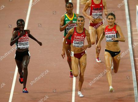 Kenya's gold medal winner Hyvin Kiyeng Jepkemoi, Tunisia's silver medal winner Habiba Ghribi and Germany's bronze medal winner Gesa Felicitas Krause, from left, compete in the women's 3000m steeplechase final during the World Athletics Championships at the Bird's Nest stadium in Beijing