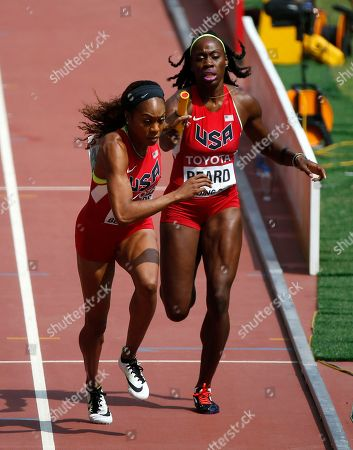 Sanya Richards-Ross, left, of the United States takes the baton from teammate Jessica Beard in a women's 4x400m relay round one heat at the World Athletics Championships at the Bird's Nest stadium in Beijing
