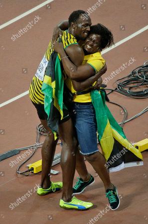 Jamaica's Usain Bolt hugs his mom, Jennifer Bolt, after Usain won the men's 100m final at the World Athletics Championships at the Bird's Nest stadium in Beijing