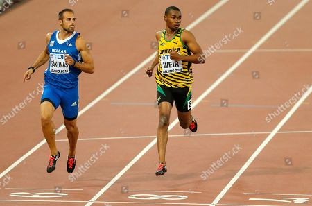 Stock Image of Greece's Likourgos-Stefanos Tsakonas, left, and Jamaica's Warren Weir compete in a men's 200m heat during the World Athletics Championships at the Bird's Nest stadium in Beijing