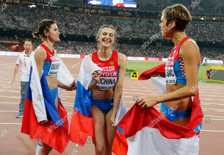 Russia's Anna Chicherova, left, Russia's Maria Kuchina, middle, and Croatia's Blanka Vlasic celebrate after the women's high jump final at the World Athletics Championships at the Bird's Nest stadium in Beijing