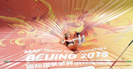 Germany's Silke Spiegelburg lands after an unsuccessful attempt in women's pole vault qualification at the World Athletics Championships at the Bird's Nest stadium in Beijing