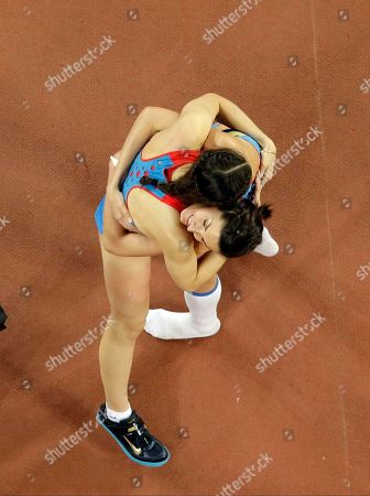 Russia's Maria Kuchina, left, and Russia's Anna Chicherova celebrate after the women's high jump final at the World Athletics Championships at the Bird's Nest stadium in Beijing, . Kuchina won the event and Chicherova placed third