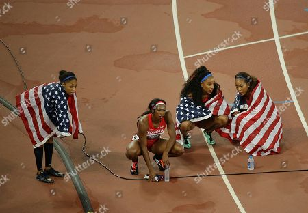 United States' Allyson Felix, United States' Francena McCorory, United States' Natasha Hastings, and United States' Sanya Richards-Ross, from left, celebrate winning the silver medal in the women's 4x400 relay final at the World Athletics Championships at the Bird's Nest stadium in Beijing
