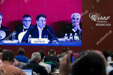 Journalists watch a screen at a media center showing a live feed of newly elected International Association of Athletics Federations President Sebastian Coe delivering his speech after the election results were announced at the IAAF Congress at National Convention Center in Beijing . The 58-year-old Coe has won a four-year term as president of the governing body for track and field, beating Sergei Bubka in an election Wednesday and given the mandate to restore the image of the IAAF amid a doping controversy