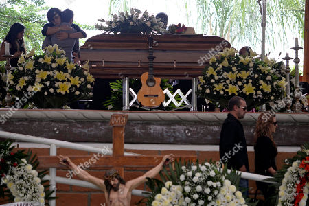 """Joan Sebastian CORRECTS THE NUMBER OF GRAMMYS AWARDED TO SEBASTIAN - People pay their respects during the wake for Mexican ballad singer Joan Sebastian at his home in Teacalco, Mexico, . Sebastian, one of Mexico's great ballad singers, died on July 13 at age 64. He was best known for sentimental love songs like """"Tatuajes"""" and """"Secreto de Amor,"""" sometimes set to simple guitar arrangements and sometimes sung on horseback. Sebastian won four Grammy awards and seven Latin Grammy prizes during his career"""
