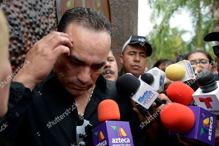 """Federico Figeroa CORRECTS THE NUMBER OF GRAMMYS AWARDED TO SEBASTIAN - Federico Figueroa speaks to the press during the wake for his brother, Mexican ballad singer Joan Sebastian, outside of Sebastian's home in Teacalco, Mexico, . Sebastian, one of Mexico's great ballad singers, died on July 13 at age 64. He was best known for sentimental love songs like """"Tatuajes"""" and """"Secreto de Amor,"""" sometimes set to simple guitar arrangements and sometimes sung on horseback. Sebastian won four Grammy awards and seven Latin Grammy prizes during his career"""