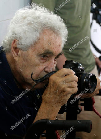 Elliott Erwitt American photographer Elliott Erwitt takes pictures of American film director Francis Ford Coppola at the International School of Film and Television in San Antonio de Los Banos, near Havana, Cuba, . Erwitt, 87, is in Cuba for a two-week visit