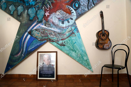 A recently awarded prize given to Cuba's Silvio Rodriguez stands at the singer's studio,bottom left, in Havana, Cuba, . Rodriguez accepted the prize from a non governmental study center that supports political pluralism on the island