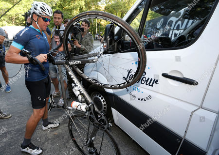"""Lance Armstrong holds his bike during the charity ride """"Le Tour, One Day Ahead,"""" between Rodez and Mende, southern France, . While the Tour de France is going, Armstrong takes part to a charity ride called """"Le tour-One Day Ahead"""" with the goal of raising money to cure Leukemia"""