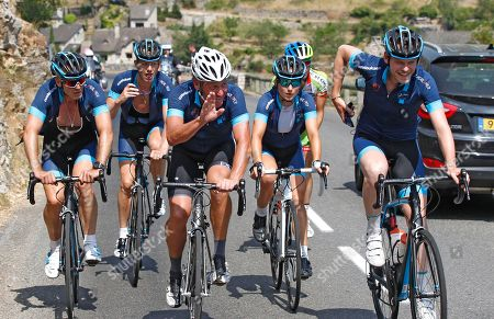"""Lance Armstrong, centre, waves as he cycles with members of the team for former England football international Geoff Thomas, not pictured, during the charity ride """"Le Tour, One Day Ahead,"""", between Rodez and Mende central France. While the Tour de France is going, Armstrong takes part to a charity ride called """"Le tour-One Day Ahead"""" with the goal of raising money to cure Leukemia. Former English footballer who won nine caps for England soccer team, Geoff Thamas was diagnosed with Leukemia in 2003 and he founded the Geoff Thomas Foundation to raise funds to fight the disease"""