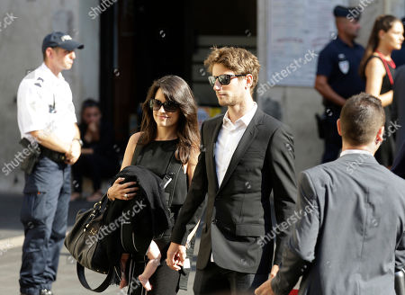 Lotus driver Romain Grosjean of France and Marion Jolles arrive at the Sainte Reparate Cathedral to attend the funeral of French Formula One driver Jules Bianchi in Nice, French Riviera, . Bianchi, 25, died Friday from head injuries sustained in a crash at last year's Japanese Grand Prix. He had been in a coma since the Oct. 5 accident, in which he collided at high speed with a mobile crane which was being used to pick up another crashed car