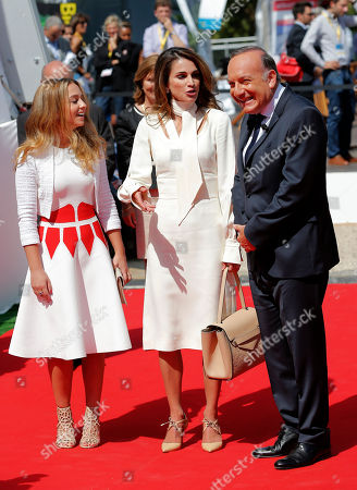 Queen Rania of Jordan, center, with her eldest daughter Princess Iman, left, are greeted by Head of the French employers' union MEDEF, Pierre Gattaz as they arrive for the opening of France employer's union MEDEF annual meeting in Jouy en Josas, outside Paris