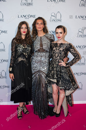 From left, Alma Jodorowsky, Daria Werbowy and Lily Collins pose during a photocall for the Lancome 80th anniversary party during the Haute Couture fashion week in Paris, France