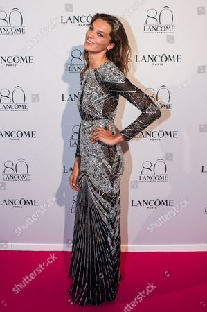Daria Werbowy poses during a photocall for the Lancome 80th anniversary party during the Haute Couture fashion week in Paris, France