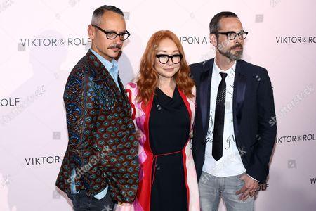 From left, Viktor Horsting, Tori Amos and Rolf Snoeren attend the Viktor&Rolf FlowerBomb fragrance 10th anniversary party in Paris