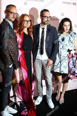 From left, Viktor Horsting,Charli XCX, Tori Amos and Rolf Snoeren attend the Viktor&Rolf FlowerBomb fragrance 10th anniversary party in Paris