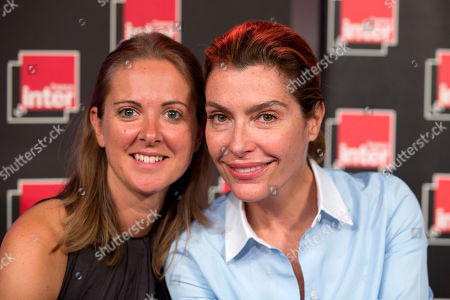 France's state radio corporation Radio France journalists Charline Vanhoenacker, left, and Daphne Roulier pose during a press conference at Radio France headquarters in Paris, France