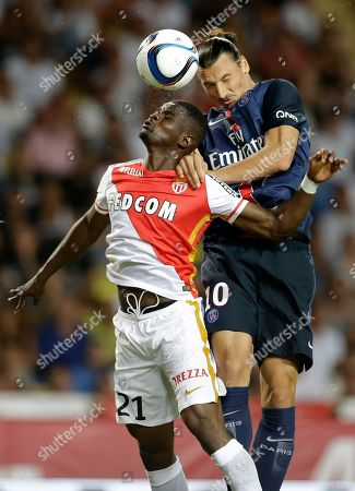 PSG player Zlatan Ibrahimovic, right jumps for the ball with Monaco player Elderson Uwa Echiejile during their French League One soccer match, in Monaco stadium