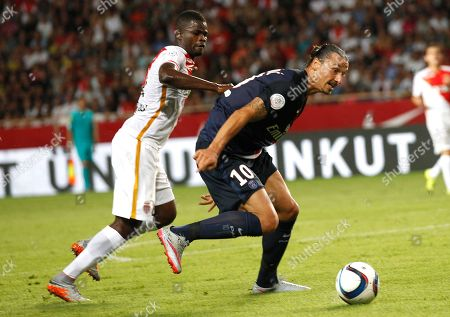 PSG player Zlatan Ibrahimovic, right, challenges for the ball with Monaco player Elderson Uwa Echiejile during their French League One soccer match, in Monaco stadium