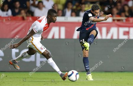 PSG player Angel Di Maria, right, challenges for the ball with Monaco player Elderson Uwa Echiejile during their French League One soccer match, in Monaco stadium