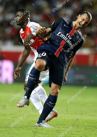 PSG player Zlatan Ibrahimovic, right, clashes with Monaco player Elderson Uwa Echiejile during their French League One soccer match, in Monaco stadium